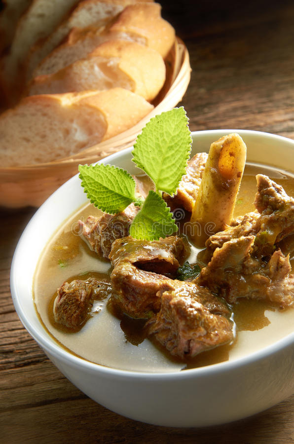 Lamb Soup. With bread on background stock image