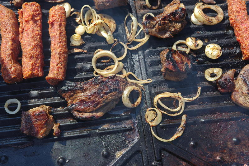 Lamb steak on the grill and meat rolls 2 royalty free stock photos