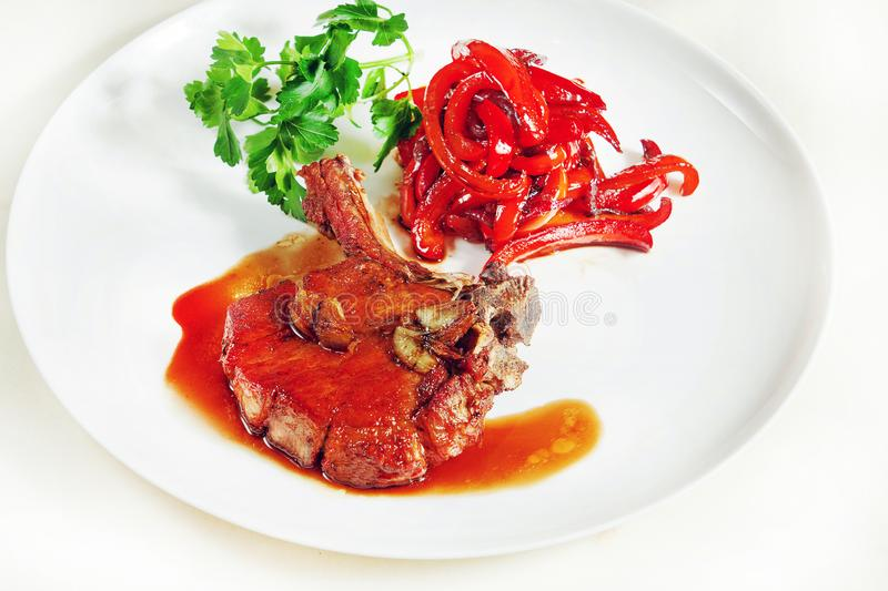 Lamb stew with red pepper stock images