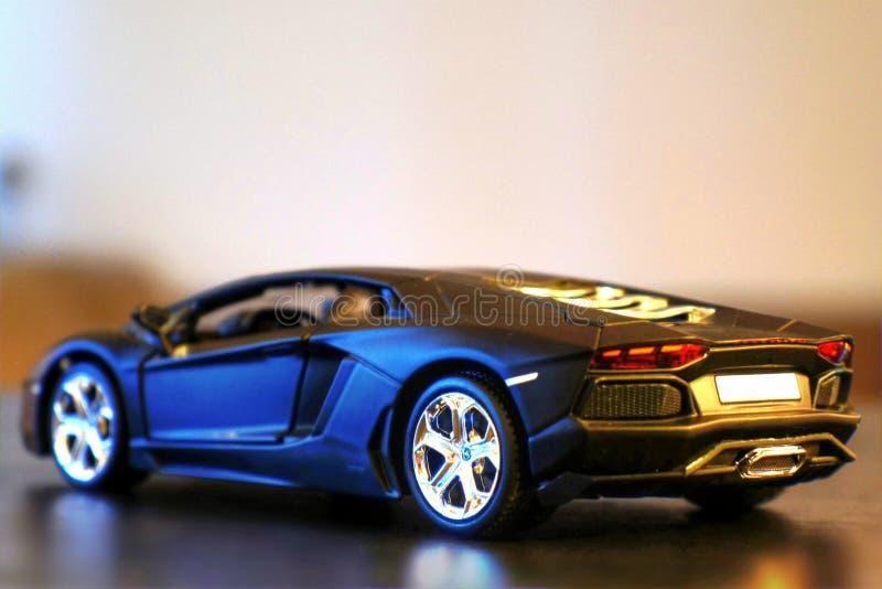 Lamborghini Aventador LP700-4 model car lateral/rear. Lamborghini Aventador LP700-4 die-cast metal model toy 1:24 scale, Black. Lateral / rear view royalty free stock photo
