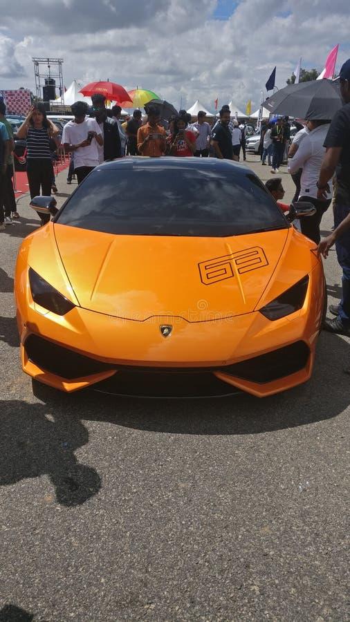 Lamborghini, the Costly Drive! All eyes, beautiful car stock photo
