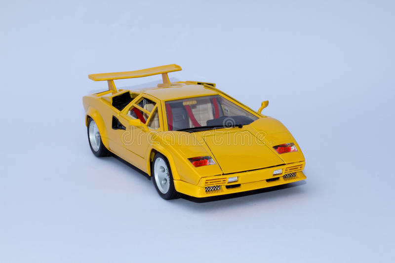 Lamborghini Countach. Model of a yellow Lamborghini Countach (1988) viewed from the front with white background stock photography