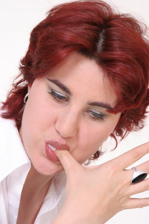 Lamedura del dedo buena foto de archivo