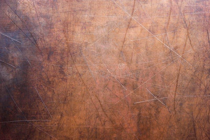 Lamina di metallo spogliata, struttura di vecchio piatto di rame fotografia stock