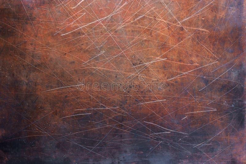 Lamina di metallo spogliata, struttura di vecchio piatto di rame fotografie stock