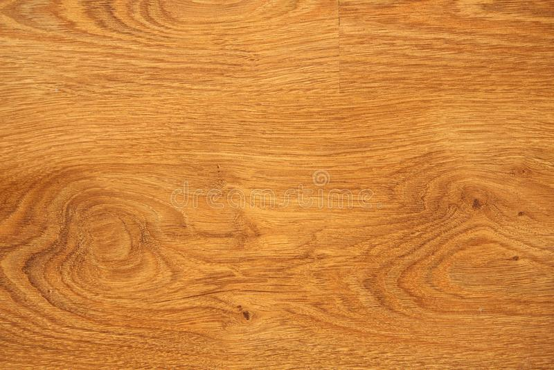 Laminat- eller parkettgolv - trä som däckar material Bakgrund arkivbild