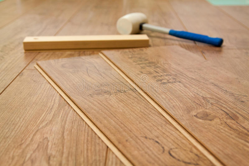 Laminate floor and tools used stock photography