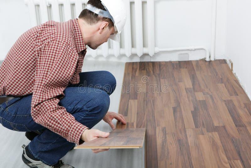 Laminate flooring installation royalty free stock images
