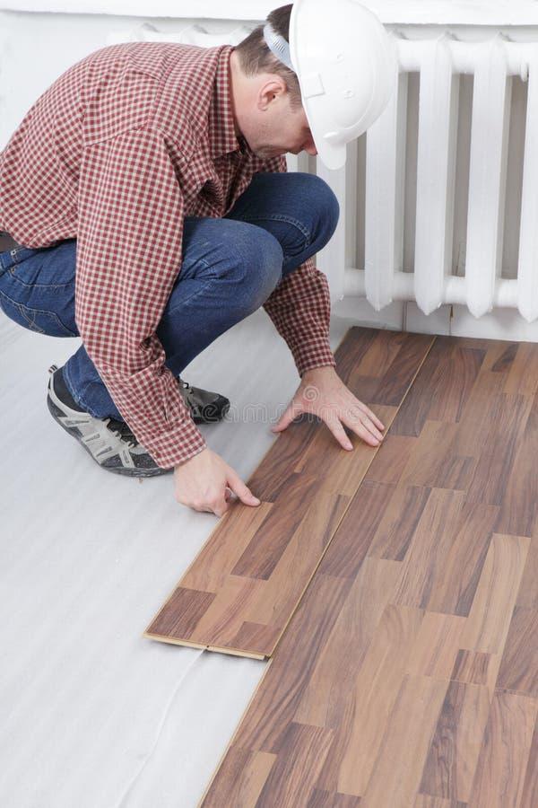Laminate flooring installation royalty free stock image