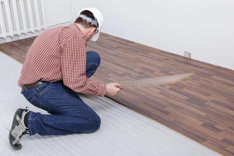 Laminate flooring installation stock photo