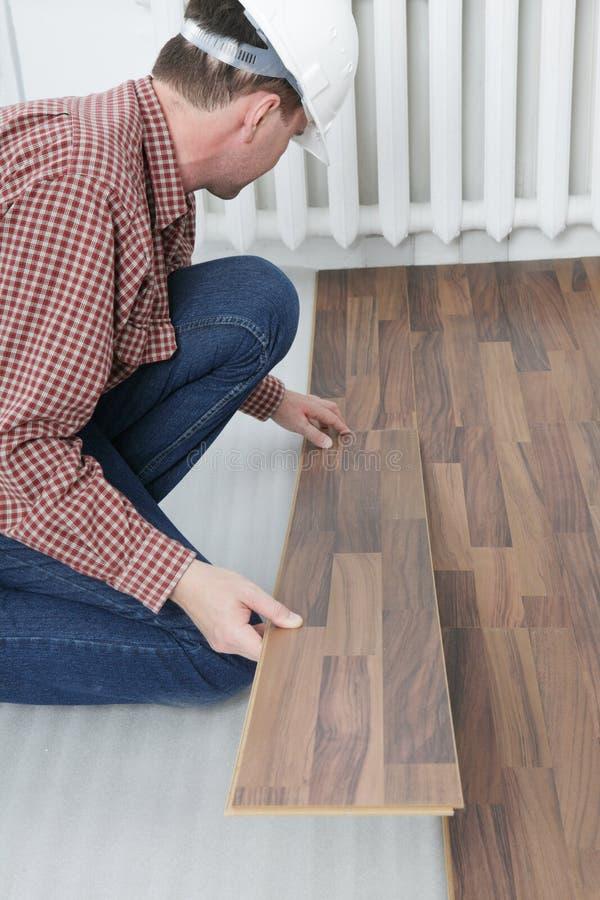Laminate flooring installation stock images