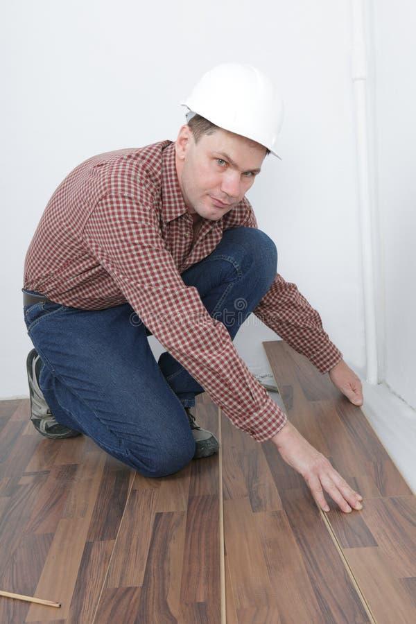 Laminate flooring installation stock image