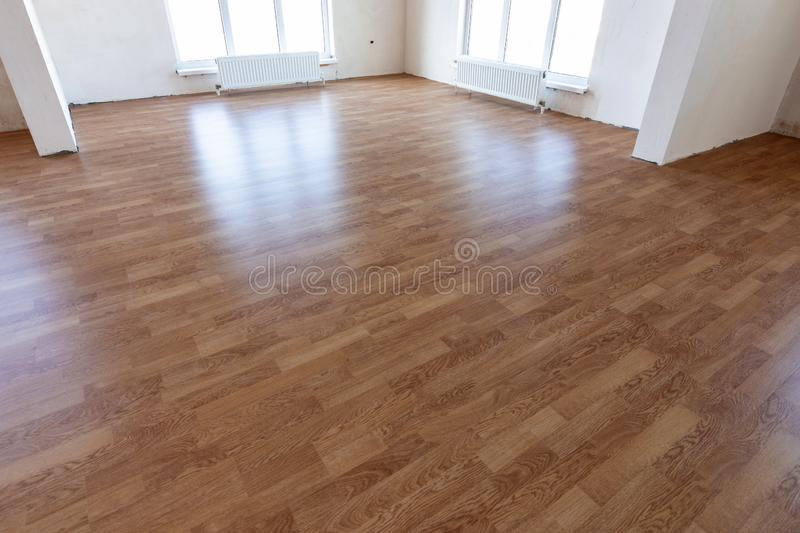 Laminate flooring in the interior of a spacious room in a new building royalty free stock photo