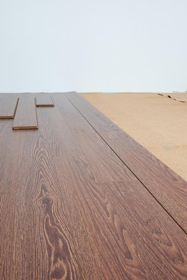 Laminate. Flooring oak color chocolate lying in the room stock image