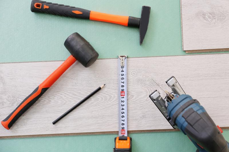 Laminate installing equipment. With planks royalty free stock image