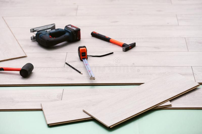 Laminate installing equipment. On planks royalty free stock images