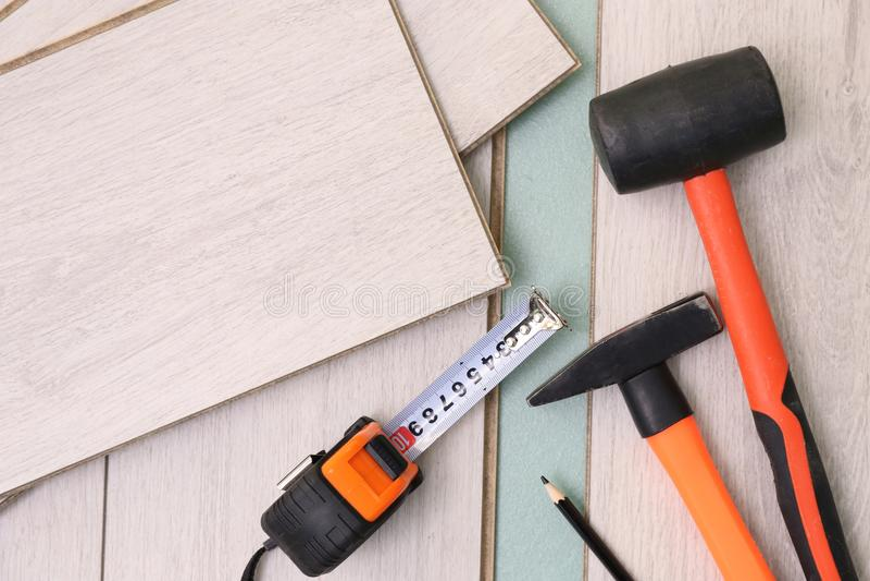 Laminate installing equipment. On planks royalty free stock image