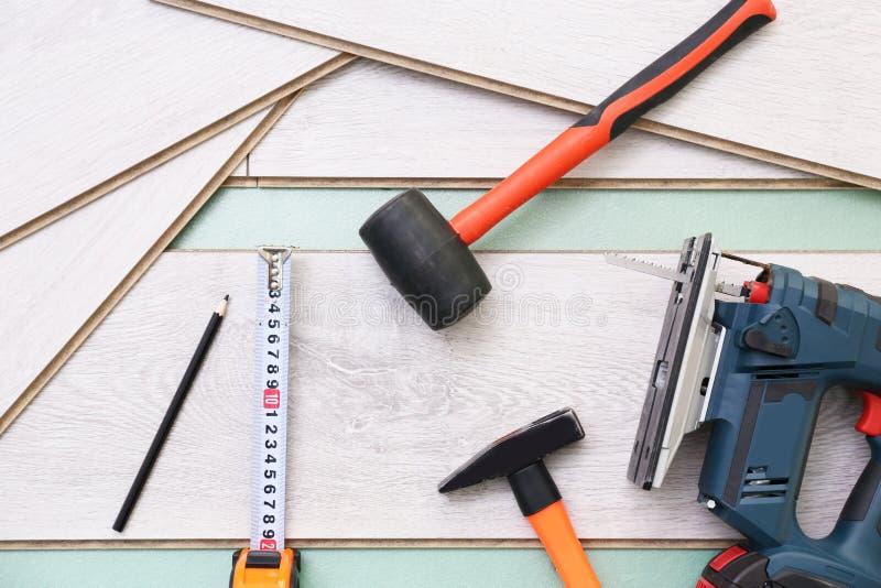 Laminate installing equipment. On planks royalty free stock photo