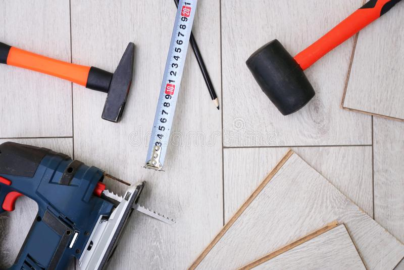 Laminate installing equipment. On planks stock image