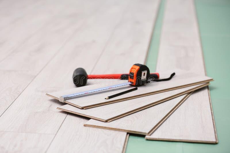 Laminate installing equipment. On planks royalty free stock photos