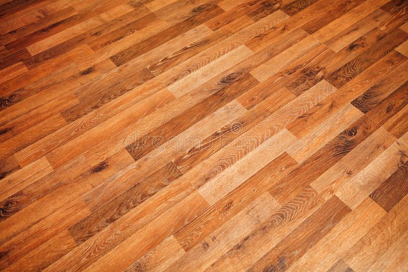 Laminate parquet floor texture. Closeup view royalty free stock photos