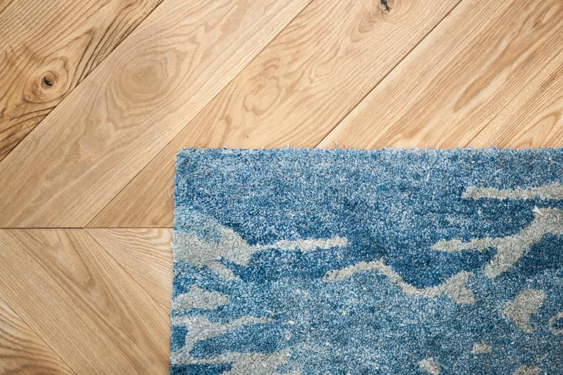 Laminate parquete floor. Light wooden texture. Beige soft carpet. Warm interior design. stock image