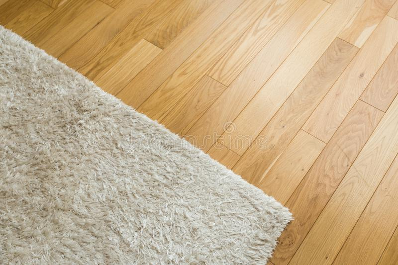 Laminate parquete floor. Light wooden texture. Beige soft carpet royalty free stock photography