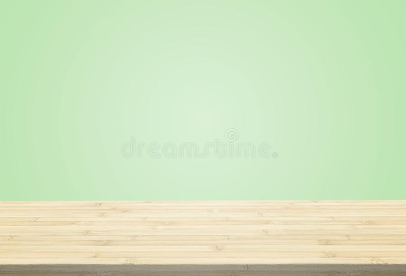 Laminate table top on pastel green background. Can put or montage your products royalty free stock image