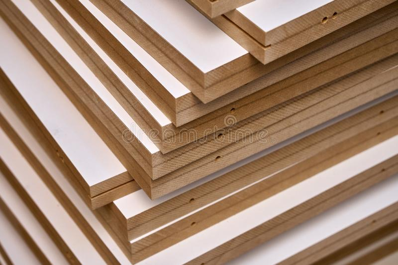 Laminated MDF bookshelves. Production of wood furniture. Furniture manufacture. Close-up royalty free stock images