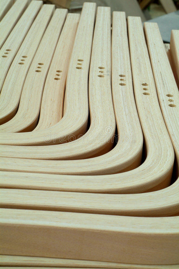 Laminated, wooden parts for furniture production stock photos