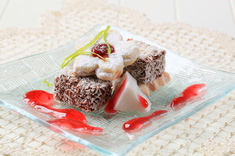 Lamingtons and jam biscuits stock image