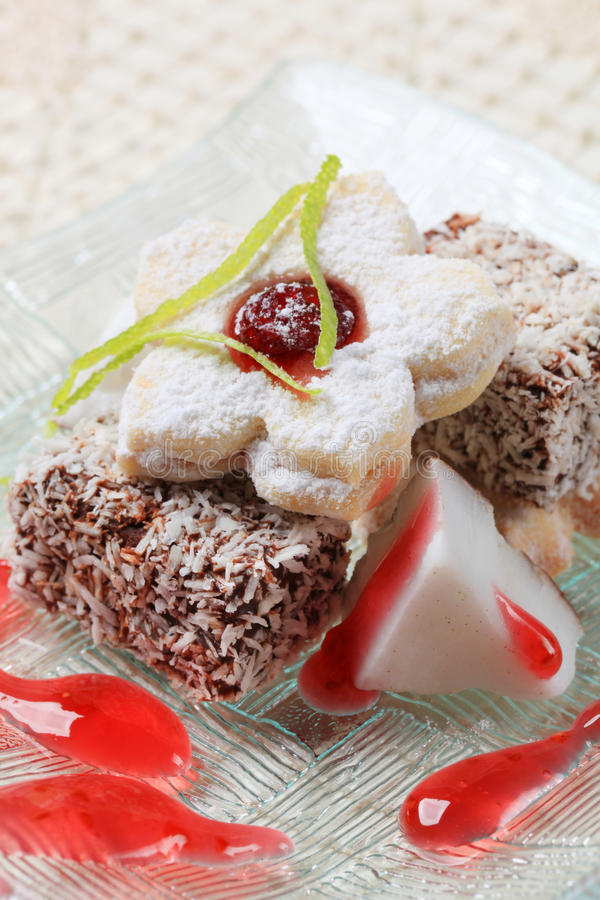 Lamingtons and jam biscuits stock images