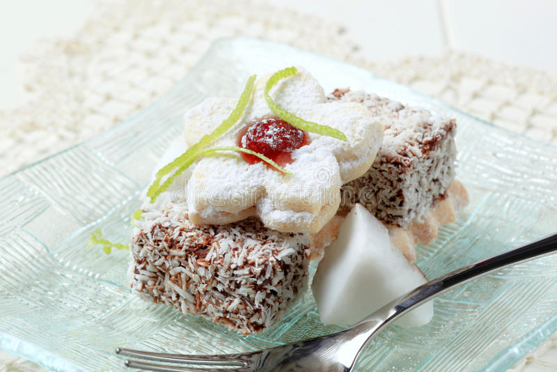 Lamingtons and jam biscuits stock photography