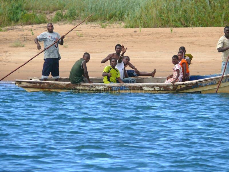 Download LAMIRANGA, MOZAMBIQUE - 4 DESEMBER 2008: Unknown Men Carry Passe Editorial Image - Image: 39459500