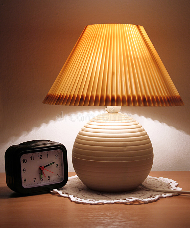 Lamp. Night lamp with clock on a desk royalty free stock photography