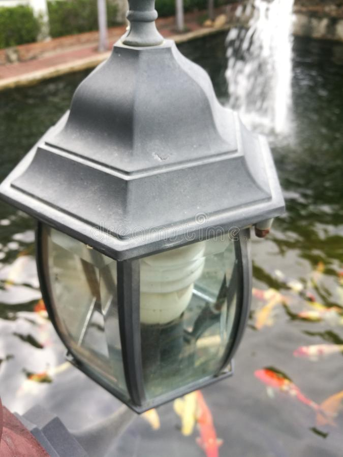 Lamp above the carp pond stock photography