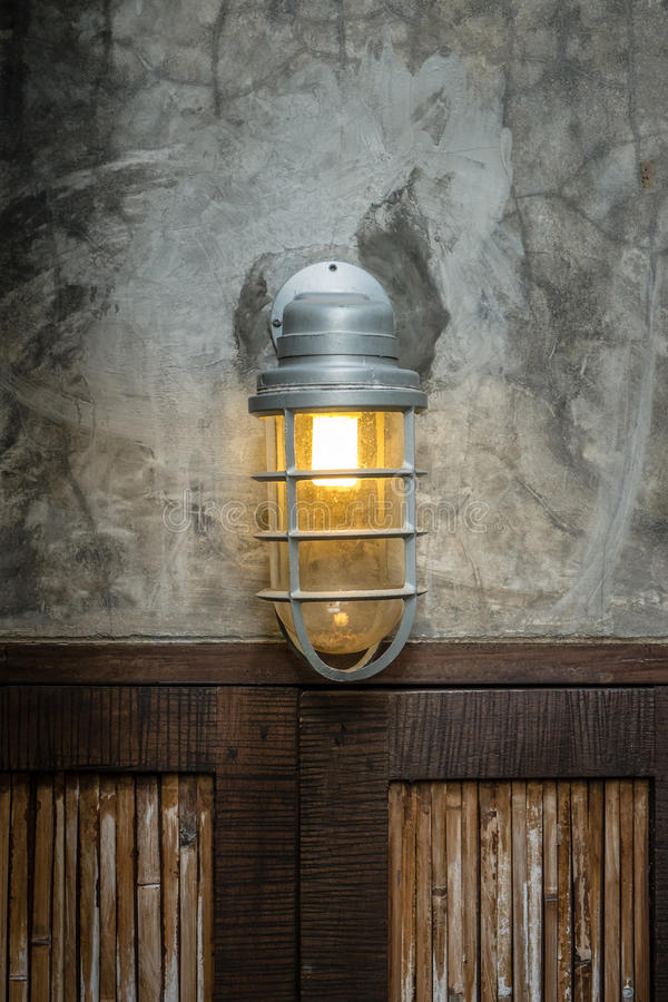 Lamp above the wood doors royalty free stock photo