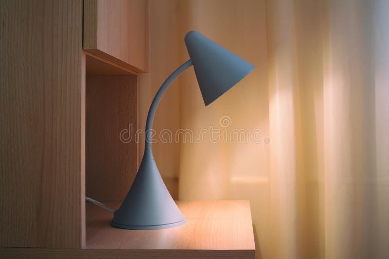Lamp on bedside table royalty free stock photography