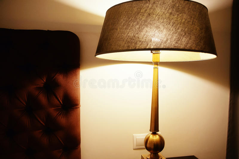 Lamp on the bedside table. Photo of lamp on the bedside table stock photography