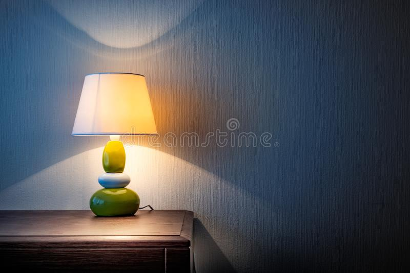 Lamp on a dresser or night table royalty free stock images