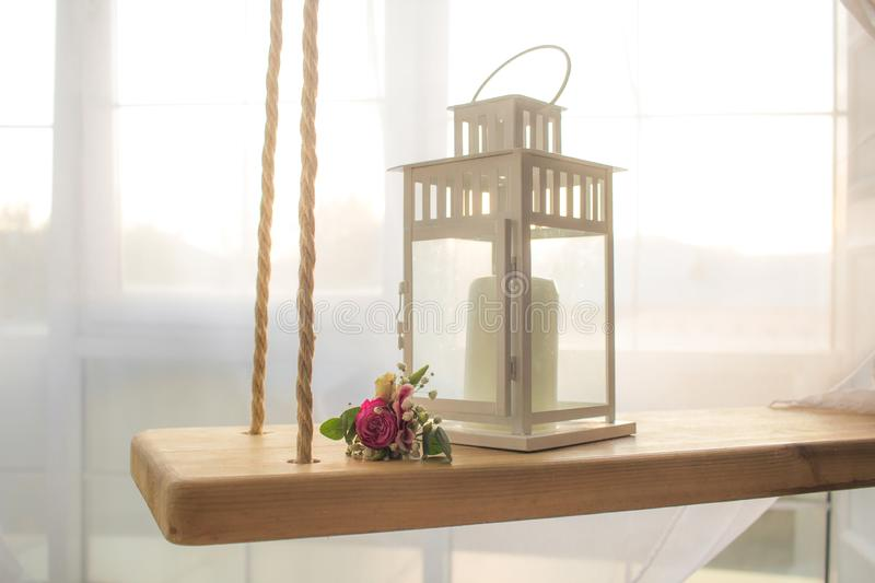 Lamp and flower on swing with window wedding background royalty free stock image