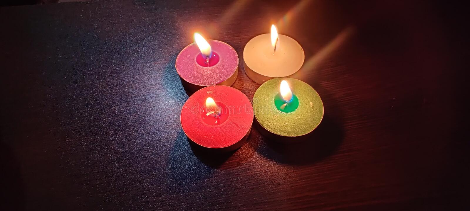 4 lamp green pink yellow red flame royalty free stock photo