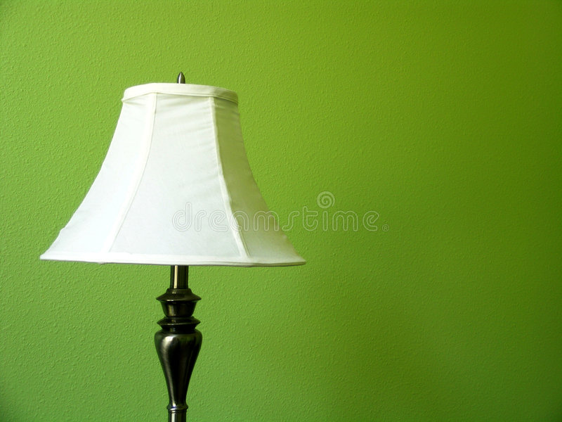 Lamp on Green wall stock images