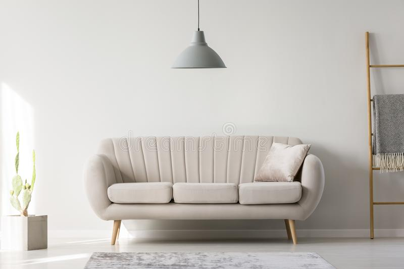 Lamp hanging above couch royalty free stock images