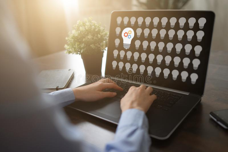 Lamp icons on screen. New idea. Think outside the box. royalty free stock image
