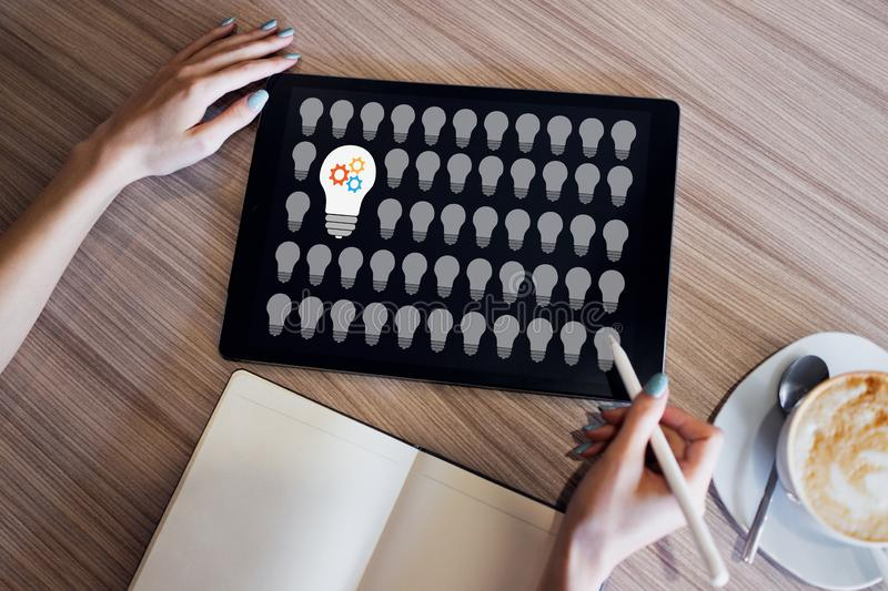 Lamp icons on screen. New idea. Think outside the box. stock photo