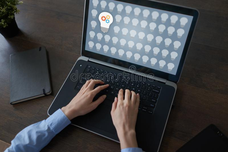 Lamp icons on screen. New idea. Think outside the box. royalty free stock photography
