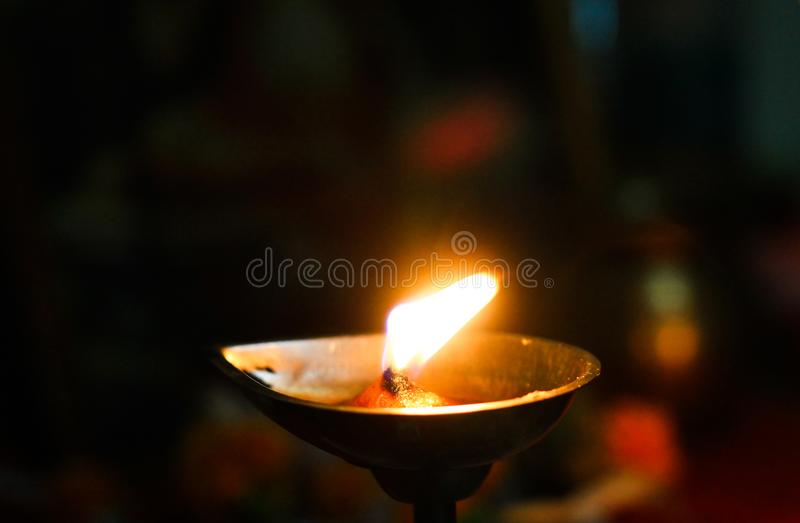 Lamp and inscense sticks as an offering to god for worship stock images