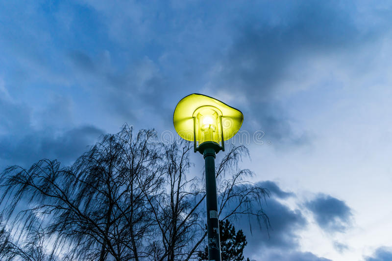 A lamp just after sunset in a park in Berlin royalty free stock photo