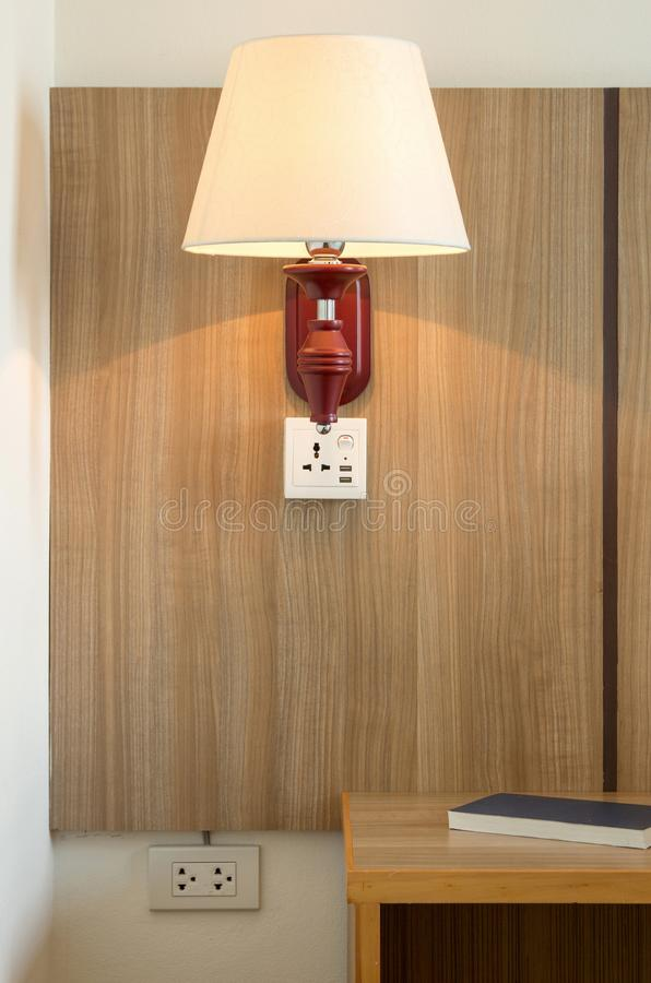 Lamp light and bedside table. In the room royalty free stock images